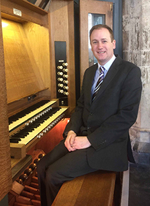 Phillip Sangwine sat next to an organ