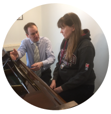 a student and teacher in music lessons