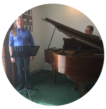 a music lesson with student and teacher on piano