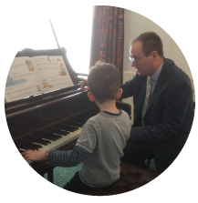 a child learning to play piano